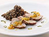 Roasted pork ribs with a lentil medley