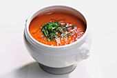 Finely puréed tomato soup with herbs