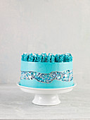 A caramel cake with turquoise icing