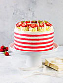 A red velvet cake on a cake stand