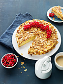 Swedish almond cake with redcurrants, sliced