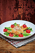 Saddle of rabbit in strudel pastry with braised tomatoes