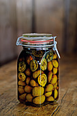 Pickled candied walnuts in a flip-top jar