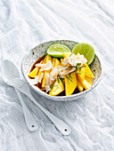 Fruit salad with mango, kaffir lime and coconut chips