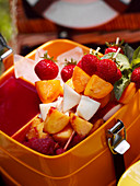Fruit kebabs in a lunchbox