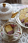 Biscuits shaped like a tea bag in a teacup