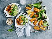 Harissa fish fingers with kinda mushy peas