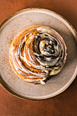 Freshly baked cinnamon roll with cream cheese glazing