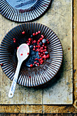 The remains of frozen berries in a bowl