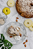 Apple cake with almond crumbles and cream