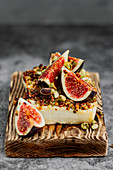 Baked feta cheese with pistachios, honey and figs