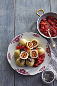 Potato dumplings with plums and broth