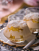Tiramisu with mango and grated coconut