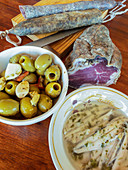 Traditional aperitif - Sausages, olives and anchovies