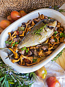 Baked gilthead with mushrooms