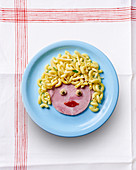 A ham face with pasta hair