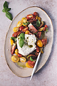Heirloom tomato salad with burrata and olive oil