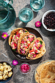 Vegeterian tortillas with cauliflower and pickled onions