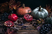 Autumn pomegranate, pumpkins, grapes and chestnuts