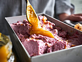 Blueberry ice cream with orange compote