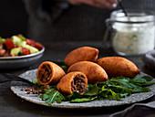 Kibbeh – oriental bulgur croquettes filled with minced meat