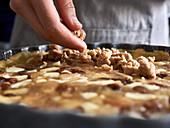 Vegan apple crumble tart being made