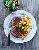Rump steak with rosemary potatoes and garden salad