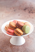Various colourful macaroons on a cake stand