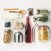 Glass and metal jars with beans, pasta, lentils, milk, juce