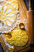 Making lemon biscuits with a lace doily