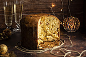 Sliced Panettone - Italian Christmas Dessert with Wine Glasses