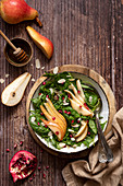 Spinach Pear Pomegranate Salad with Honey dressing