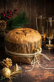Panettone - Italian Christmas Dessert with Wine Glasses