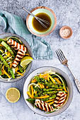 Zoodle salad with green asparagus and halloumi