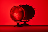 Spinning globe casting coronavirus cell shadow