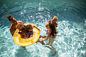 Family playing in inflatable ring