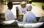 Senior women friends talking on summer patio