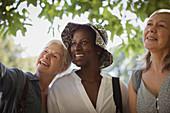 Happy senior women friends in park