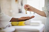 Close up woman receiving house rental keys