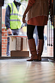 Woman receiving packages from delivery person