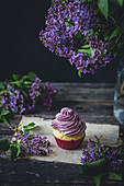 Vanilla cupcake with purple frosting
