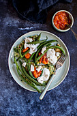 Courgette cakes with homemade tomato sauce, joghurt, French beans and goat cheese