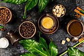 Kaffee, Milch, Zucker, Gewürze und Blätter
