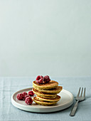 Gluten-free zucchini pancakes with corn flour and raspberries
