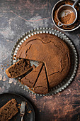 Chocolate cake with sifter and cocoa powder