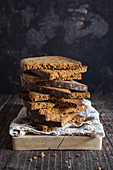 Stack of rye bread slices on wood board
