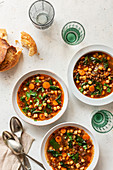 Chickpeas and lentil soup in bowls