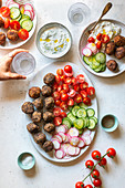 Vegetarian meatballs with tzatziki sauce and vegetables