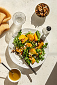 Golden beet salad with arugula, feta cheese and walnuts
