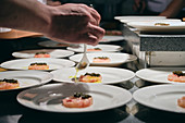 Chefs preparing dishes in French restaurant